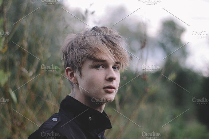 Young blonde man in the park. People Photos. $5.00