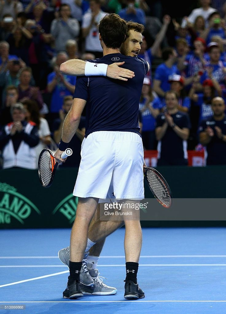 Andy Murray and Jamie Murray of Great Britain celebrate match point in the doubles match against Yasutaka Uchiyama and Yoshihito Nishioka of Japan on day two of the Davis Cup World Group 1st round tie between Great Britain and Japan at Barclaycard Arena on March 5, 2016 in Birmingham, England.