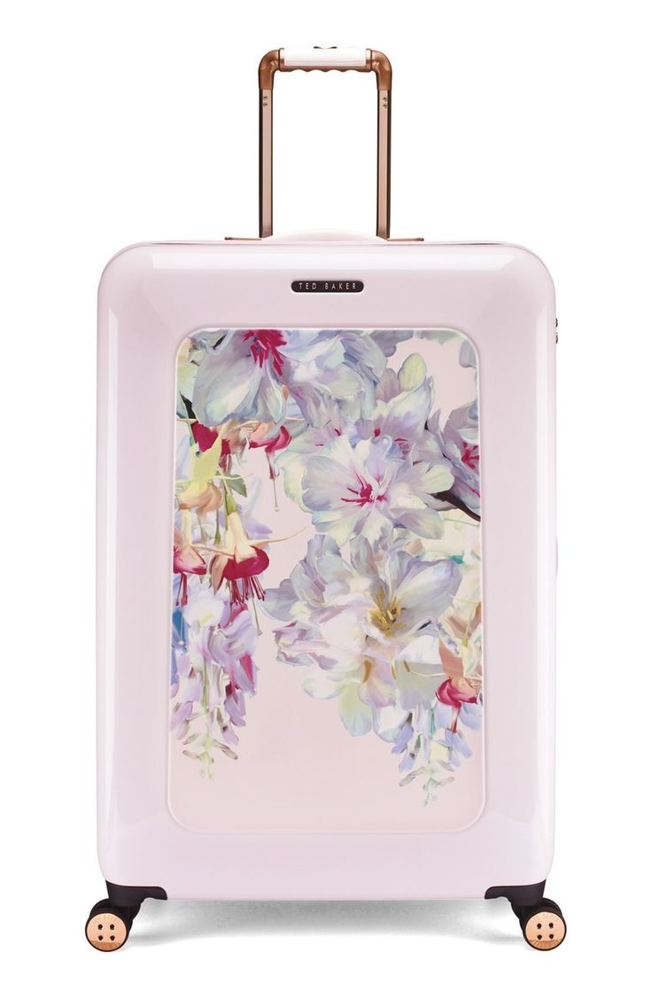 Travel in style with this lightweight suitcase from Ted Baker. It's designed with four smooth-rolling 360-degree wheels for easy concourse navigation. A lush floral print and pretty blush hue ensure it stands out from the crowd at baggage claim.