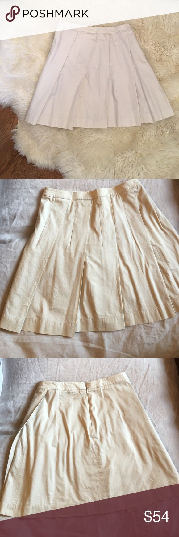Theory Skirt A summer must have! Pleated in the front, but flat in back -- a brilliant design by Theory! This skirt has all the cuteness of pleats but without the bulk around the waist! Really super summer wardrobe stable. Looks so cute with a plain white tee or tank with flats, sandals or flip flops! I've also worn it with a navy Boyfriend Blazer and pointed Dior pumps. It's also adorable with a little summer cashmere sweater. Classic, versatile style. Great price! Theory Skirts Midi