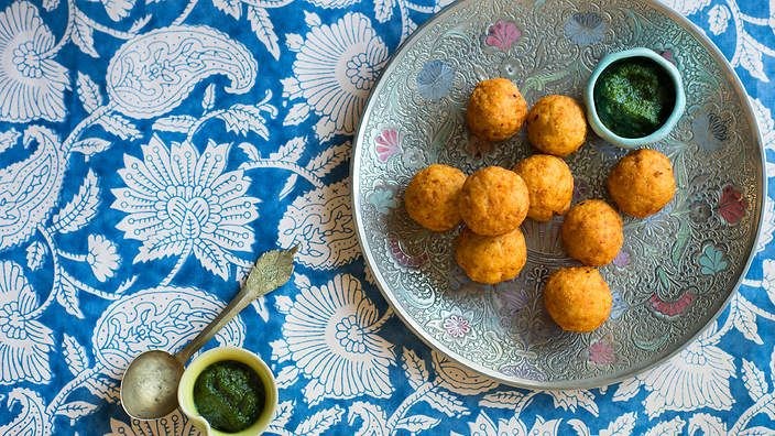 Spiced potato dumplings with green chutney (buff vada). Listen to the audio recipe.