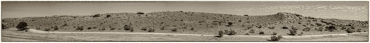 """""""Desert of the Kalahari Redux"""" has been published on Pascal Parent Photos  More information at http://wp.me/p4WBG2-b5 This is the last of 3 Monochrome Panoramic of the Kalahari Desert taken on the road back from Mata Mata. You may have noticed that the camera has changed from a Canon EOS 300D to a 400D, we had an accident during that trip and both my Sigma 170-500mm and my 300D where damaged beyond repairs. We had to drive back to Upington where we where lucky to find a Can"""
