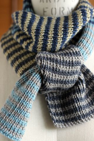 One by One, Two by Two Scarf Project: Muffler was created in one-by-one ribbing, alternating two row stripes. Shifting blocks of five different colour pairings were made, keeping one of the colours constant over two blocks and carrying the colour not in use up the side.