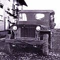 """World War II Era Photo of Slat Grill  Willys made its first 25,000 MB Jeeps with a welded flat iron """"slat"""" radiator grille. Today, Jeep proudly retain the historical connection to it predecessor by using a trademarked grille featuring a standard number of vertical openings or 'slots'."""