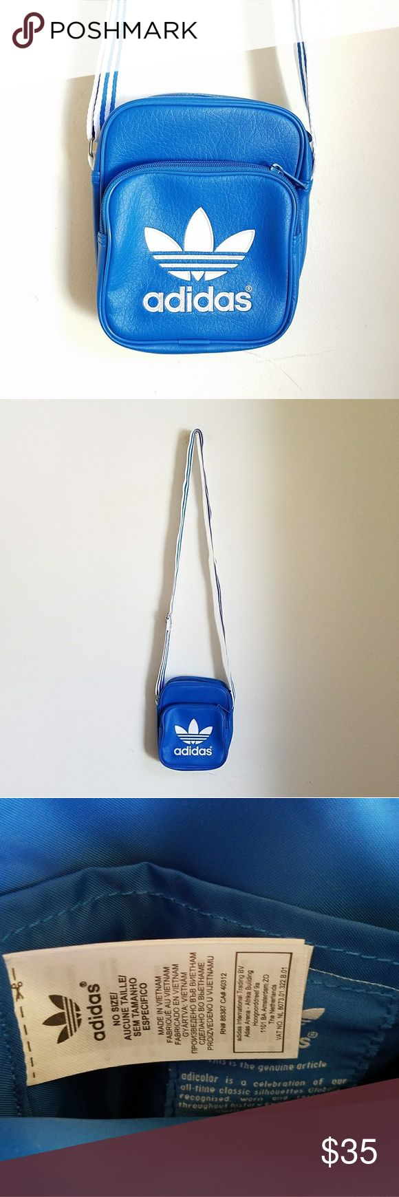 """Adidas Adicolor retro hip hop x-body bag Supah cool Adidas Adicolor logo faux leather crosboddy bag. Blue / white combo.   This is such a trooper! Perfect size to carry all your essentials, looking cute AF ♡   Measurements:  6 x 7 x 2""""   I wore it once or twice. (I am a backpack person) Like new condition.    ● Cool discounts on bundles    Adidas adicolor messenger x-body crossbody purse bag pastel blue Lolita kawaii hip hop sporty spice grunge street urban wear free alternative apparel…"""