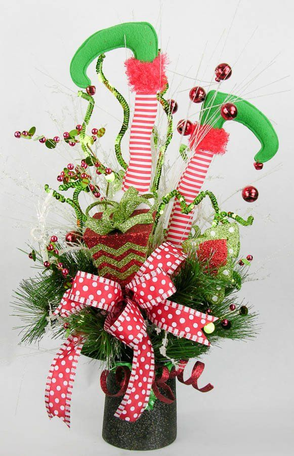 Decorate your home with this fun holiday arrangement ready to accent any place in your decor you want to add a little fun and whimsy. Striped elf legs with jingle bells with curly sequinned picks, sno