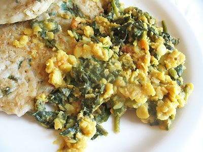 TOOR DAL AND SPINACH: 1 cup toor dal or yellow split peas 1 1/2 teaspoons cumin seeds 1/4 teaspoon asafetida 1 large tomato, cut into 8 or 12 thin wedges 2 to 3 green chilies, seeded and chopped 1 1/2 teaspoons ground coriander 1/2 teaspoon turmeric 1/4 teaspoon cayenne 1 bunch fresh spinach, trimmed and chopped juice of 1 lemon (3 tablespoons) 1/2 teaspoon garam masala small handful of fresh parsley or cilantro, chopped