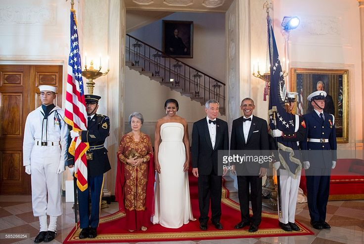 Ho Ching, first lady Michelle Obama, Prime Minister Lee Hsien Loong of Singapore and U.S. President Barack Obama pose for photographs in the White House August 2, 2016 in Washington, DC. The Obamas are hosting the prime minister and his wife for an official state dinner.