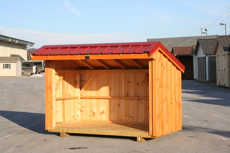 Homemade outdoor bench seat, wood shed metal roof, corner