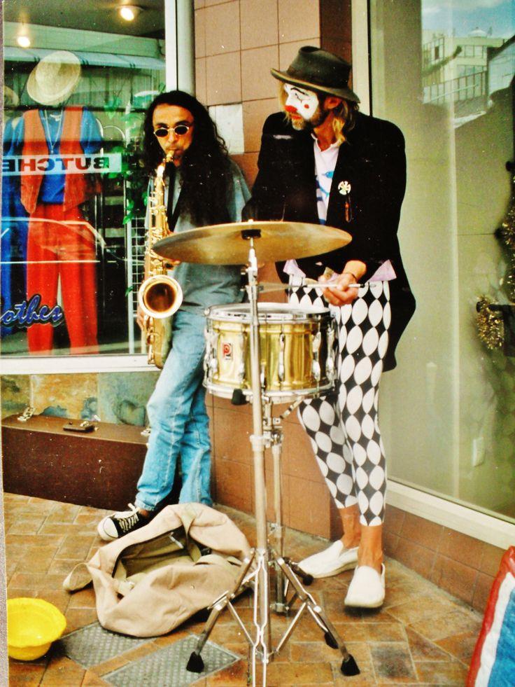 Mr Clown (housetruck murray) with Dave. Street busking . Tauranga 1990s