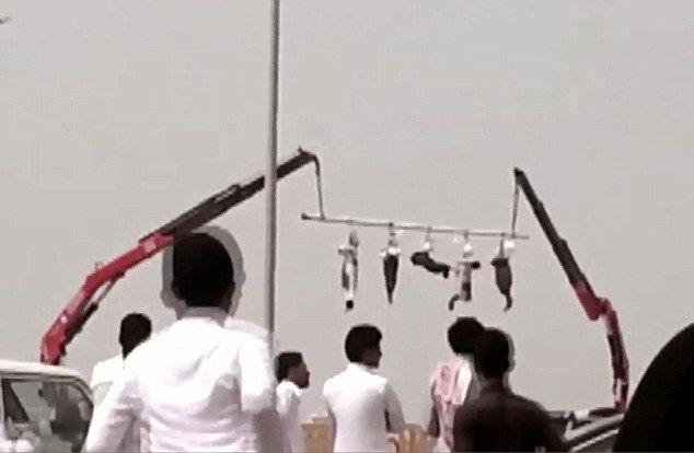 Five bodies hang from a pole suspended between two cranes in Saudi Arabia, a public display which serves as a reminder to those who might contemplate a life of crime