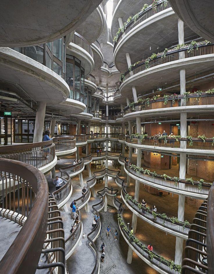 Learning Hub / Heatherwick Studio, atrium, concrete, steel railings, curved balconies