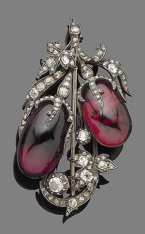 A garnet and diamond brooch, circa 1850. The oval cabochon garnet berries in closed-back settings, the leaves and stems set with rose, old brilliant and cushion-shaped diamonds, mounted in silver and gold. #Antique #Victorian #brooch
