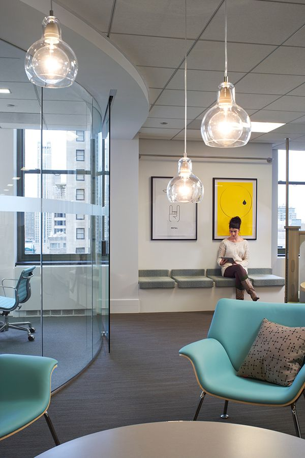 Pendant lighting, cool-relaxing colors, contemporary style - Eastlake Studio designed Pandora's new Chicago office in Tribune Tower, referencing music genres, personalities, and places though integrated artwork and streaming music in the public areas.