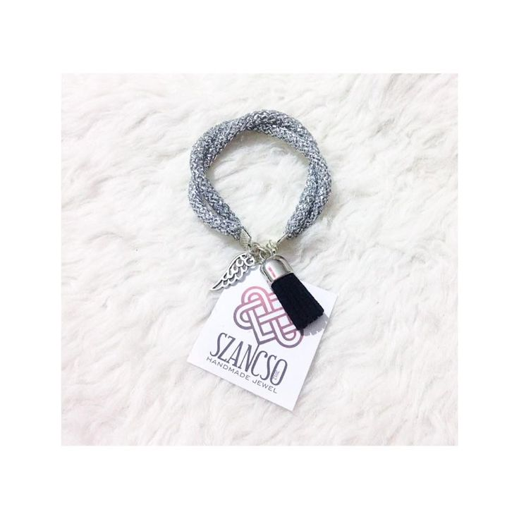 Handmade silver bracelet with angel wing charm and tassel