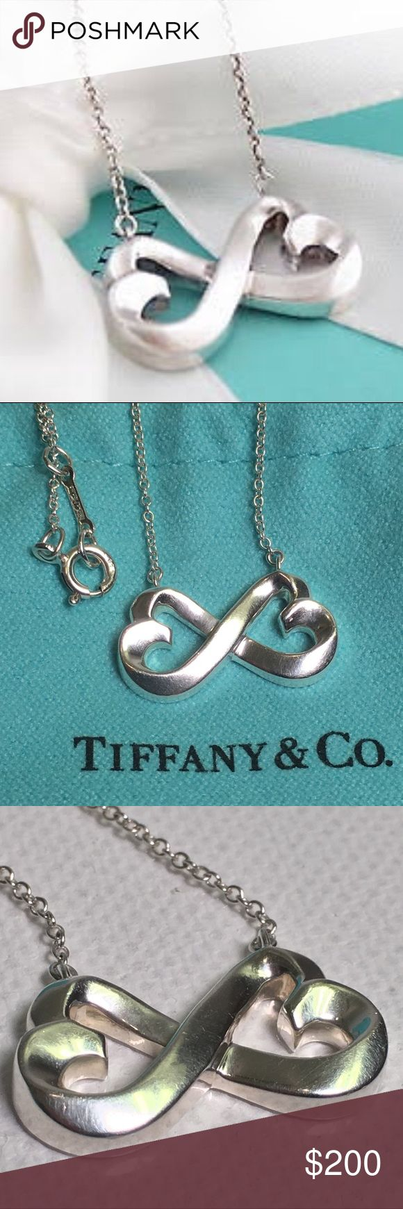 Tiffany & Co. Paloma Picasso Double Heart Necklace Tiffany & Co. Paloma Picasso Double Loving Heart Silver Pendant Necklace 100% AUTHENTIC Combining the magic of double Loving Hearts to form an Infinity sign, this Tiffany & Co. design is made for the special person in your life. Crafted from sterling silver, this pendant necklace as a lobster claw clasp.  Includes: Bag   Hardware: Silver-tone  Material: Silver 925  Necklace Total Length: 42 CM  Pendant Length: 1 CM  Pendant Width: 2 CM…