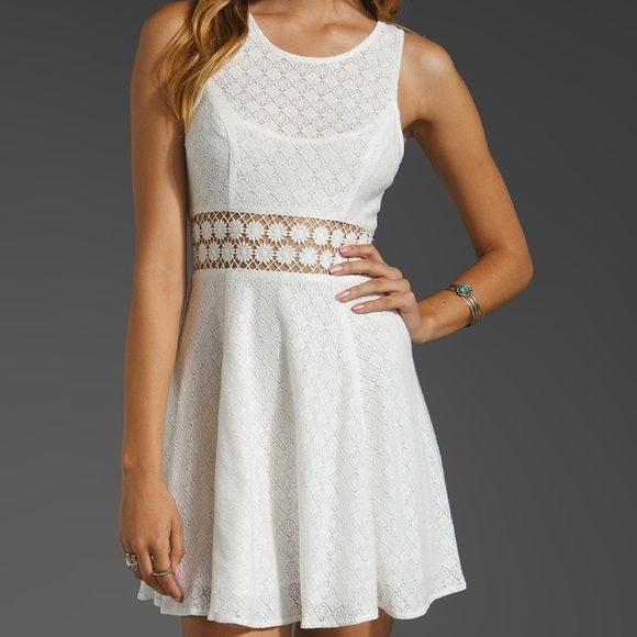 NWOT Free People Daisy Waist Dress Size 6 NWOT Free People Daisy Waist dress in white. Size 6. Really cute but I've just never used it. Free People Dresses