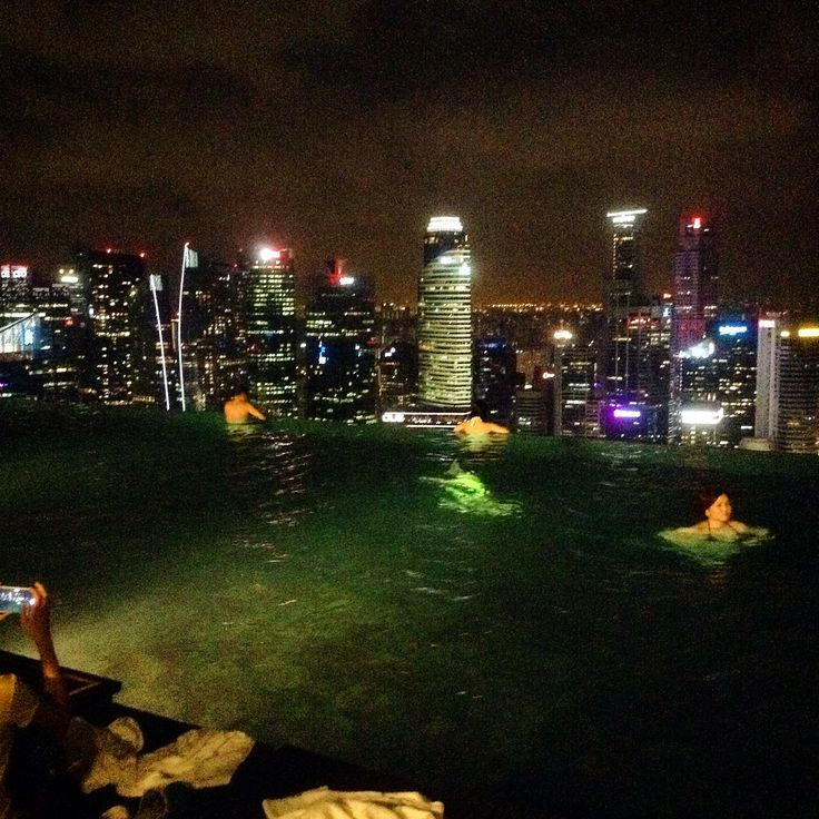 By the poolside at night at #MarinaBayhotel #Singapore