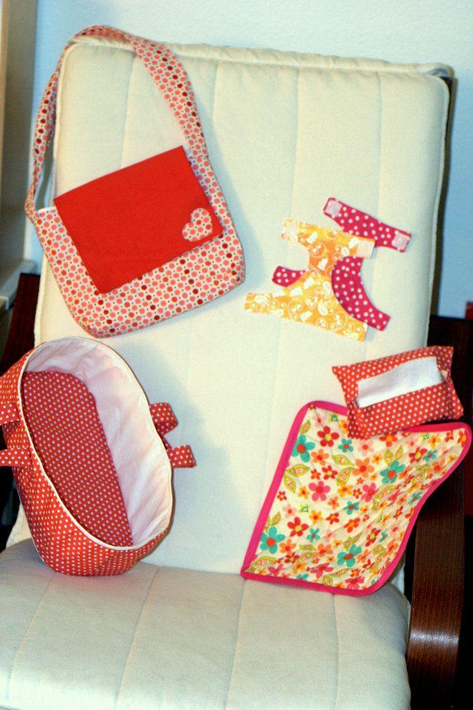 Doll paraphernalia:  diaper bag, bassinet, blanket, wipes, diapers