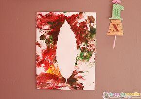 Peindre la silhouette d'une feuille d'arbre avec de la peinture aux doigts