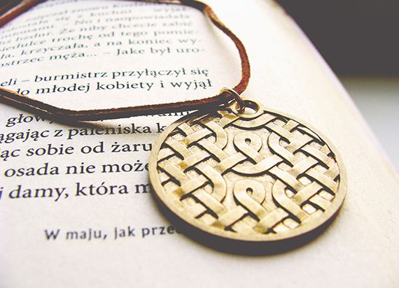 Custom pendant with Celtic knot pattern.