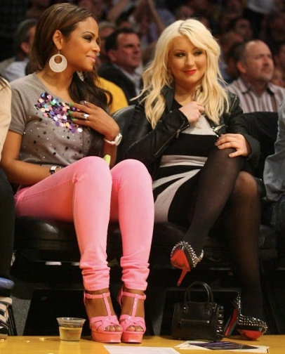 Singers Christina Aguilera and Christina Milian share some girl time as they sit courtside at the Los Angeles Lakers vs The Oklahoma City Thunder Game at the Staples Center in Los Angeles, CA.