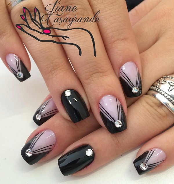 Beautiful black and periwinkle nail art design. Start off with a black and periwinkle base color then add the polishes alternately upstairs while adding the v-shape on the lighter nails.