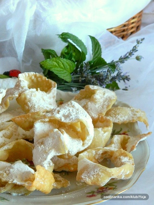 Kroštule — Coolinarika. My mum made these and she used to drop them in a brown paper bags to grab the grease after they were fried and then another bag with powder sugar in there to shake on them!