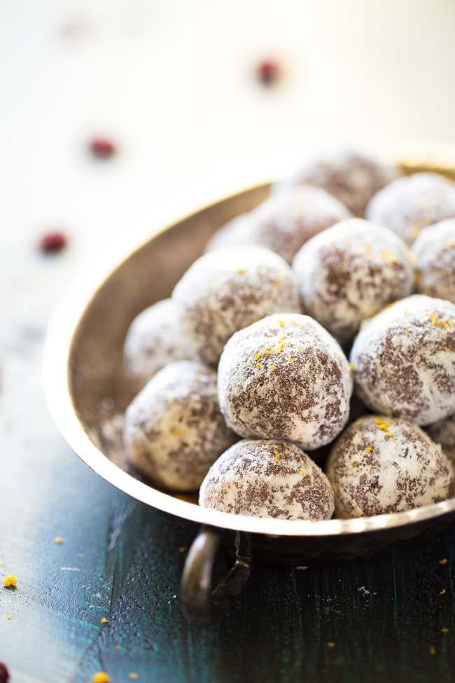 Paleo Cranberry Orange Energy Bites - A Protein Packed snack that only requires a food processor and is ready in 5 minutes! THE BEST.