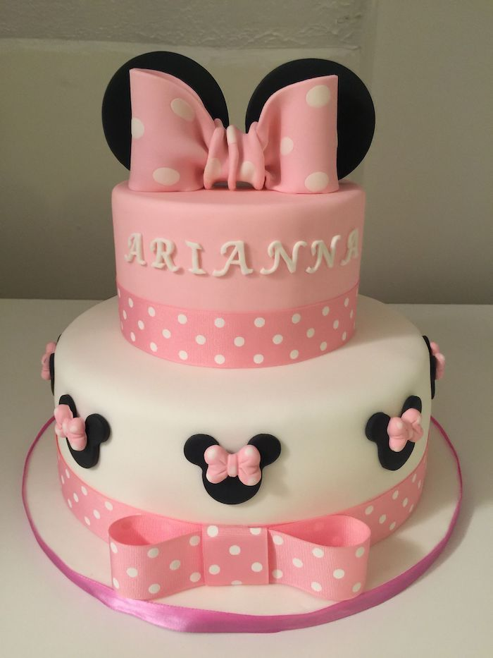 Two Tier Minnie Mouse 1st Birthday Cake Arianna White Pink Fondant Pink Bow In 2020 Minnie Mouse Birthday Cakes Minnie Mouse Cake Disney Birthday Cakes