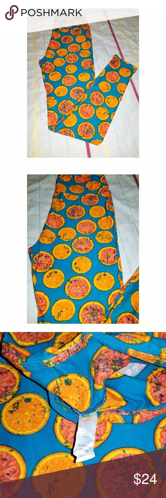 LulaRoe Sliced Oranges Leggings OS Fits 2-10 LulaRoe Sliced Oranges Leggings OS Fits 2-10 NEW in Original Packaging  No tears, stains or smells, Home is NON Smoking  I welcome OFFERS, BUNDLED Pricing and Offer FAST Shipping.   I am not a Lula Rep, Never Have been, Just a Lula Addict that purchases way too many and sometimes duplicates because I forget what I have already ordered. I have paid either retail or above. LuLaRoe Pants Leggings