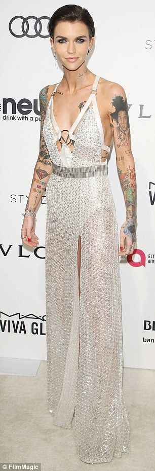 Walking tall: The brunette beauty boosted her height with a pair of silver stilettos and l...