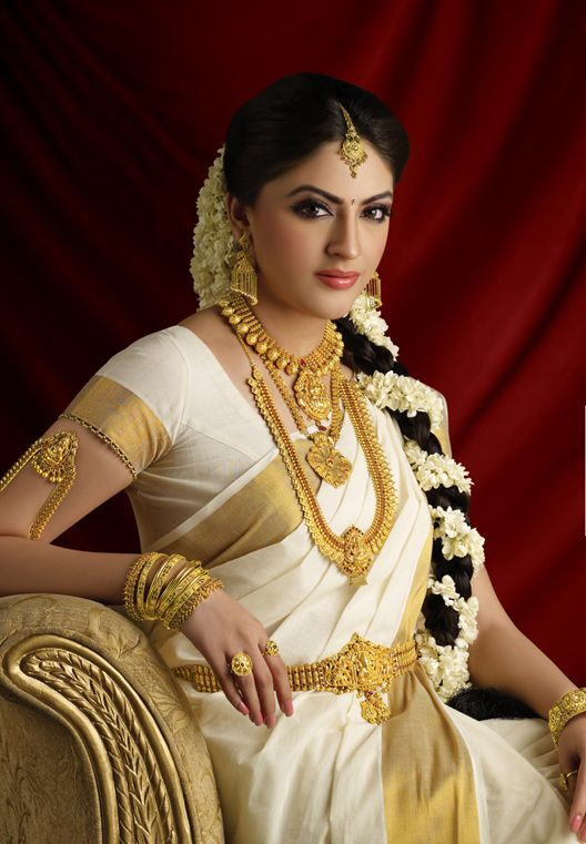 Traditional Indian Kerala Nair Bride Wearing Bridal Saree And Jewellery