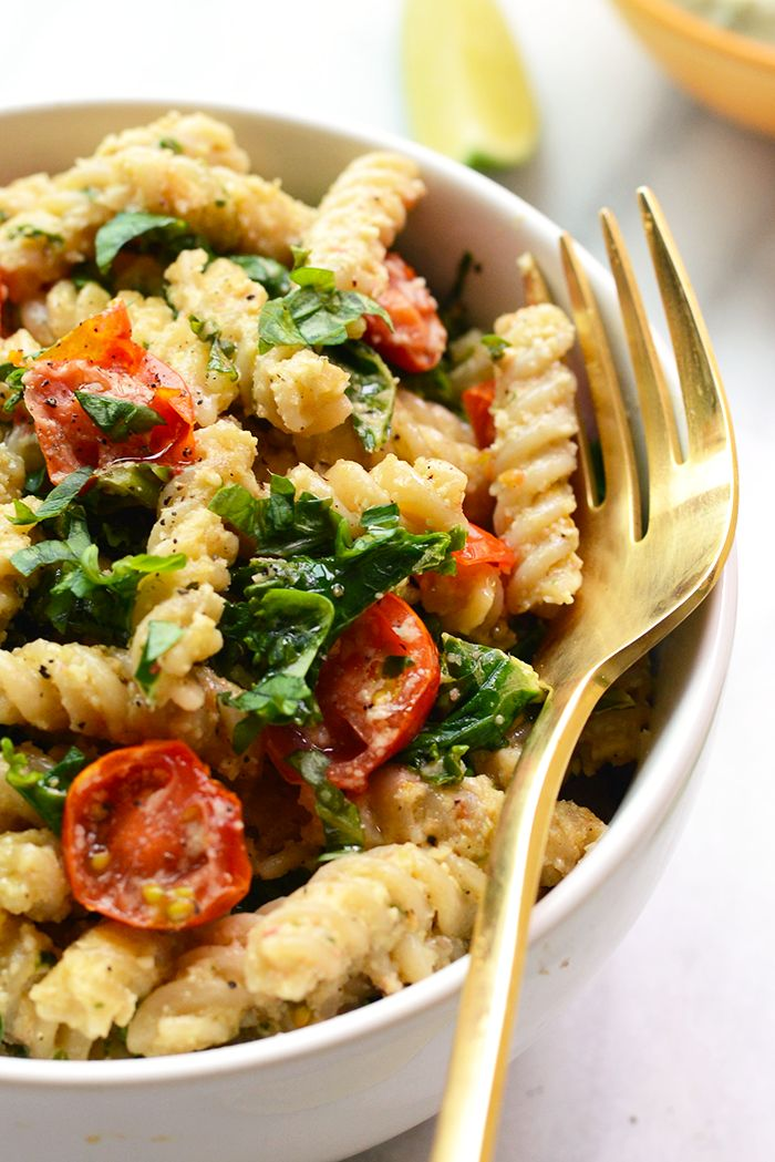 Creamy Vegan Pasta with Sautéed Kale, and Tomatoes - Fit Foodie Finds