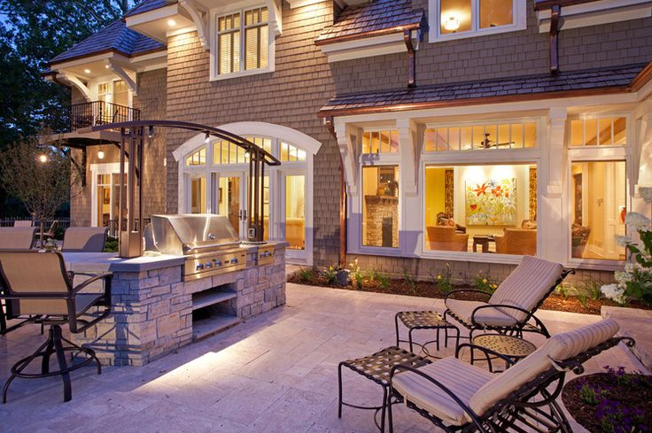 Traditional Patio by John Kraemer & Sons lighting over grill and shelves under
