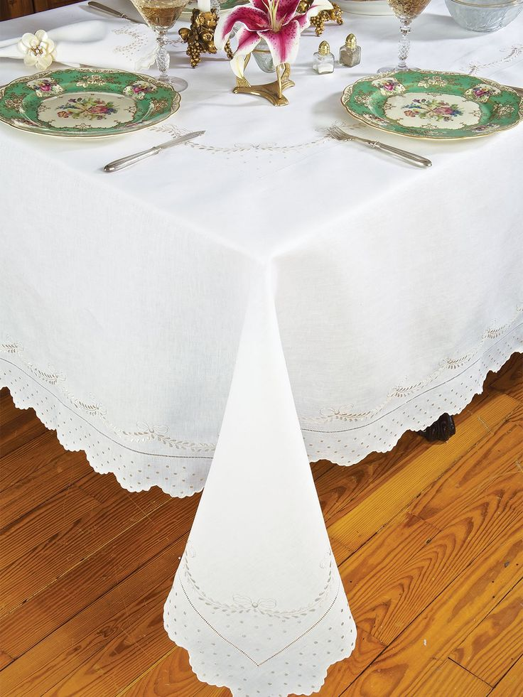 Crescente - #Luxury #Table Cloths - For all who savor the satisfaction of elegant dining, this 100% pure Italian linen calmly sets the mood. Imported #tablecloths, #placemats and #napkins in White with the refined, pure silk thread hand embroidery of leafy crescents, sprinklings of dots, and scallops-formed by mini scallops-all in a soft, creamy Beige.
