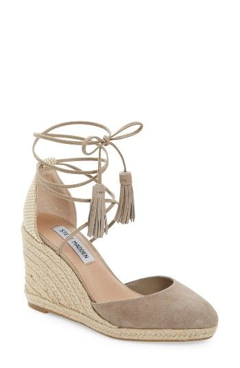 Free shipping and returns on Steve Madden Bestow Wraparound Wedge (Women) at Nordstrom.com. Layers of summery braided jute lift a suede-toe wedge that climbs even higher with slender wraparound straps that finish in a tasseled bow.