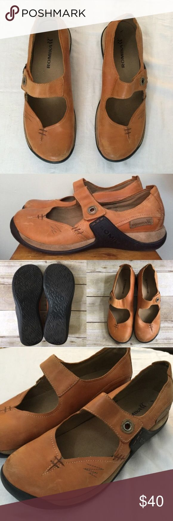 Romika | Orange Leather Outdoorsy Mary Jane Shoes Size 40. Velcro strap. Rubber soles. Orange leather with tan stitching and black Soles. Anatomically shaped footbed with arch support. Purisoft technology makes these soft and comfortable. Wear shown in photos. **i am a true 9.5 and these fit. Romika Shoes