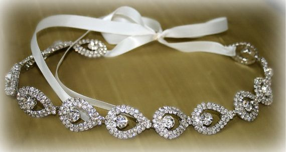 Gorgeous high quality rhinestones in the shape of tear drops. The silver plated rhinestone trim is secured with a white satin ribbon that ties into a