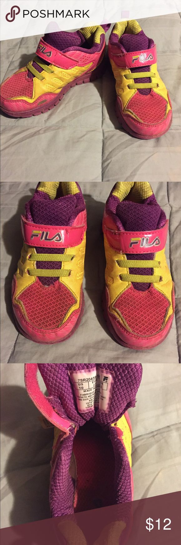 Girls tennis shoes Toddler girls size 10 FILA tennis shoes. Worn, but still has a lot of life left. Fila Shoes Sneakers
