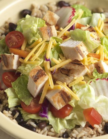 Chicken Rice and Black Bean Salad Bowl combines southwest flavors and is topped with a salsa vinaigrette.