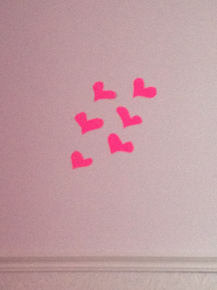 This DIY is so easy!! All you need is some couloured paper I picked this neon pink!.. And all you do is trace some hearts, cut them out and tape it to your wall!! I think this DIY is super cute!