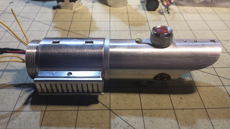 MHS Graflex Custom Lightsaber Build. Figuring out the internal layout,chassis and crystal chamber is a work-in-progress! Machined a custom LED heatsink optics mount with 28 mm 2W speaker system.