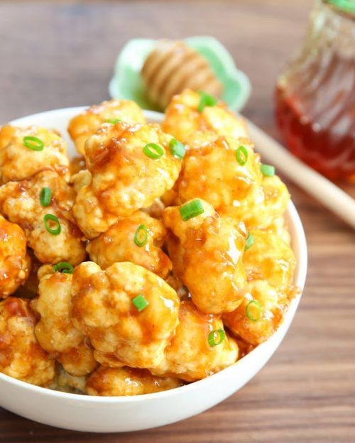 This recipe is kicked up a notch with the addition of honey garlic sauce. Honestly I think it is the sauce that brings the whole meal together. The idea of hot wings comes to mind when making roasted cauliflower and drenching it in honey garlic. You can adjust the heat of it and make them into real spicy poppers!!!