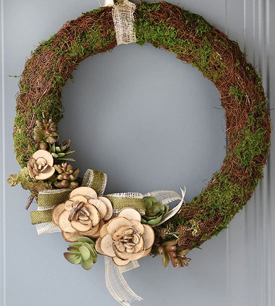 Wood Slice Rosette Wreath: If your gardening thumb isn't quite as green as you'd like, you're in luck! This DIY holiday wreath doesn't require any major upkeep. Start by gathering a pile of tiny wood slices -- these can be cut from branches in your own yard or purchased at the crafts store. Hot-glue them layer by layer to create a loose rosette shape. Next, using a moss covered wreath form as your base, glue on ribbon, faux (or live, if you prefer) succulents, and your DIY rosettes.