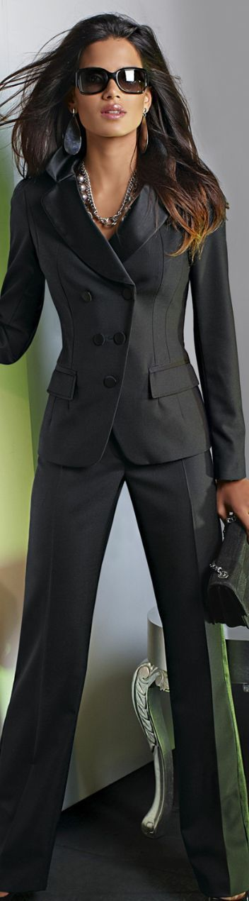 Now this is a power suit! Sophisticated and a bit sexy, charcoal gray/espressro suit with clean lines. Larger accessories add a little spice. More conservative look would include smaller earrings (hoops or even pearls) Wear with neutral shoes.