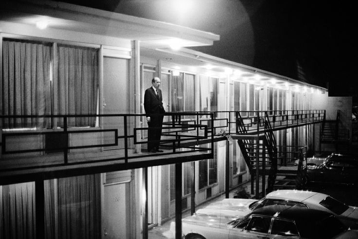 """Will D. Campbell, alone on the Lorraine Motel balcony, gazes out into the night. """"This picture was probably made as soon as we got there,"""" Groskinsky told LIFE.com. """"When I saw him standing there, alone, I thought it looked as if he was just asking himself, My God, what has happened here?"""" Read more: The Assassination of Martin Luther King Jr.: A Photographer's Story 