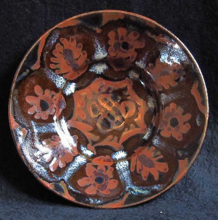 Small plate, iron decoration over tenmoku, ash glazed, kraak style.
