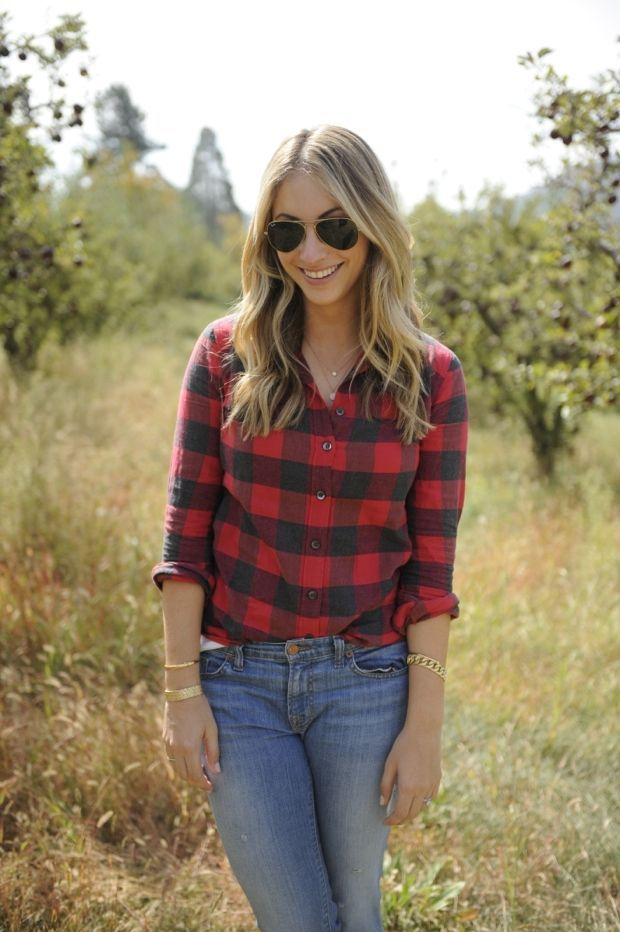 Buffalo plaid button-up with skinny jeans and aviators—perfect apple picking outfit!
