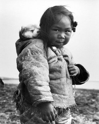 Inuit girl carrying her dog in the back (1949)
